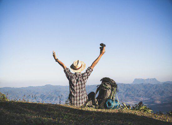 tourist-from-mountain-top-sun-rays-man-wear-big-backpack-against-sun-light (1)